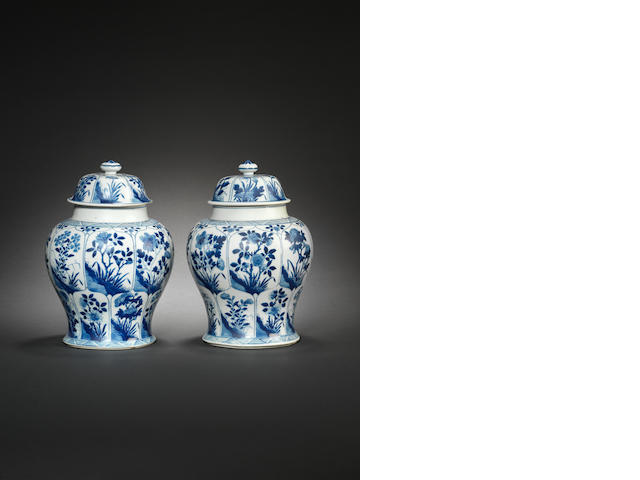 A pair of blue and white baluster jars and covers Kangxi