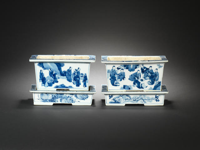 A pair of blue and white rectangular jardinières and stands Kangxi
