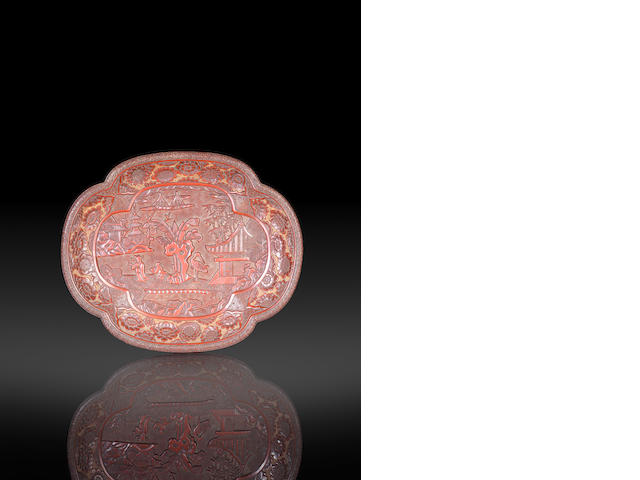 A carved cinnabar lacquer lobed oval tray  Circa 1500