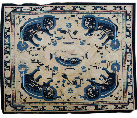 An 18th century Ningxia carpet 13 ft 6 in x 12 ft 9 in (410 x 388 cm) some wear and damage