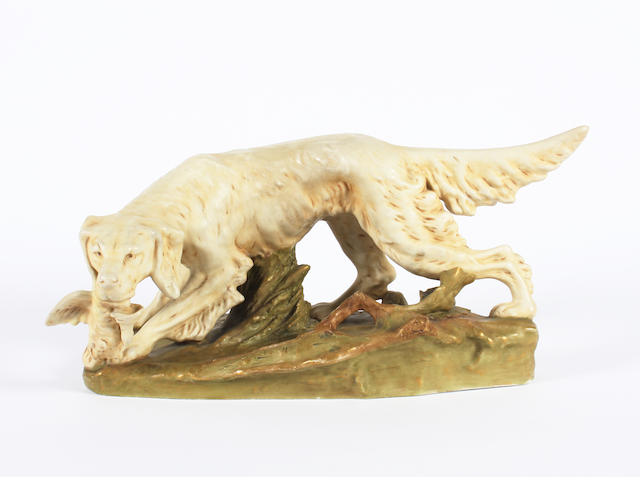 A Royal Dux model of a dog Circa 1900.