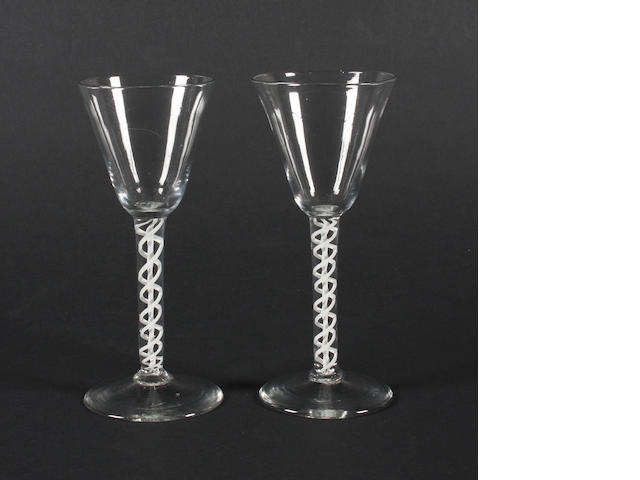 A pair of opaque-twist wine glasses Circa 1765.
