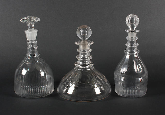 A ship's decanter and stopper and two other decanters and stoppers 19th Century.