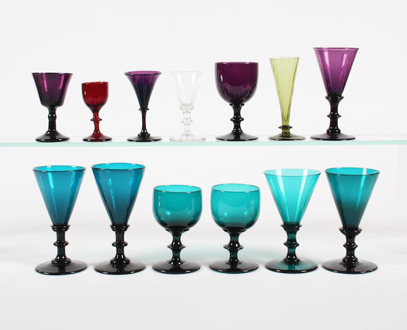 Six turquoise-tinted wine glasses, four amethyst glasses, a miniature ruby glass, a miniature wine glass and an olive green small glass Early 19th Century.