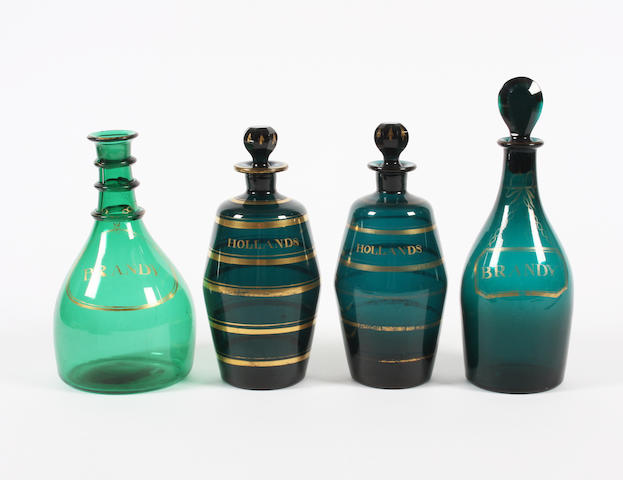 Three green glass decanters and stoppers and another green decanter Early 19th Century.