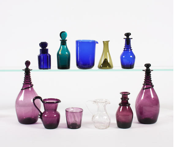 A pair of amethyst glass small decanters and a group of small glass items Early 19th Century.