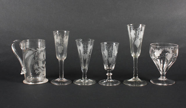 An engraved mug, four plain stem ale glasses and a goblet Late 18th Century.