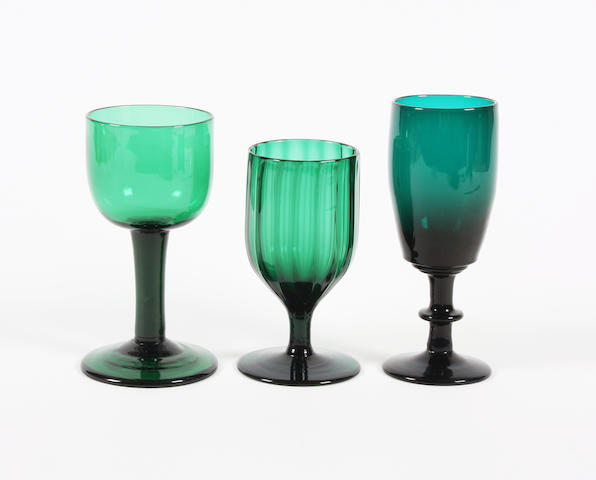 Three green-tinted wine glasses Late 18th Century.