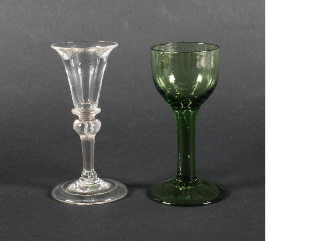 A plain stem gin glass and a green-tinted plain stem wine glass Circa 1730 and 1760.
