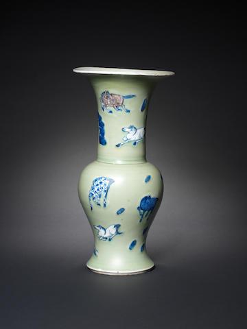 A celadon ground underglaze-blue and red 'Eight Horses of Muwang' yen yen vase Kangxi