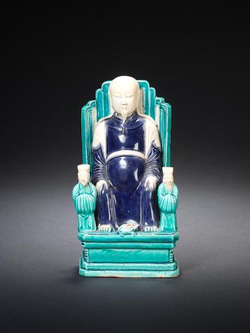 A turquoise and aubergine-glazed figure of Zhenwu Kangxi