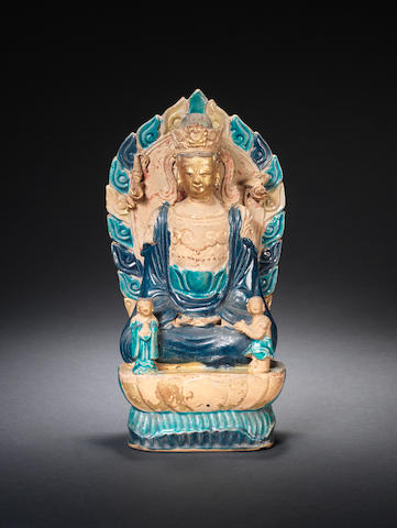 A turquoise and aubergine-glazed figure of Guanyin Dated by inscription to the 3rd year of Wanli, corresponding to AD1575 and of the period