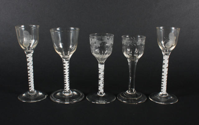 A pair of opaque-twist wine glasses, two other opaque-twist glasses and a plain stem glass Circa 1755-70.