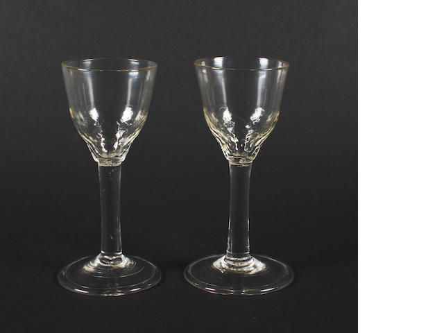 A pair of plain stem wine glasses Circa 1750.