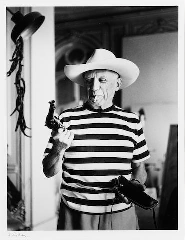 André  Villers (French, born 1930) Picasso with revolver and hat of Gary Cooper, Cannes, 1958