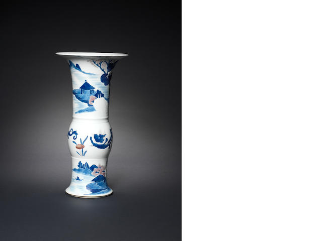 An underglaze-blue , copper-red and celadon glazed carved beaker vase, gu Kangxi