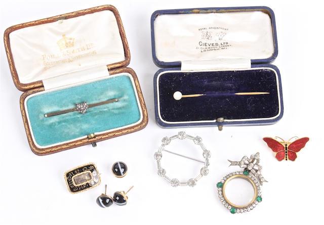 A Victorian diamond set foxes' head bar brooch