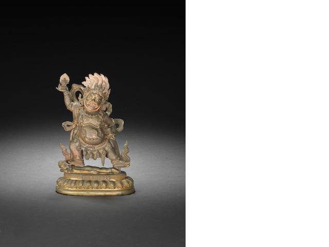 A parcel gilt-bronze figures of Mahakala and stand Cast Qianlong seven-character mark and of the period
