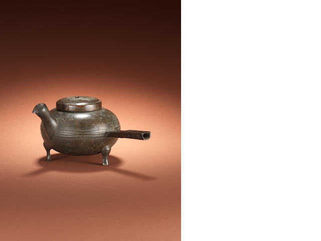 A bronze tripod kettle and cover, he Han Dynasty