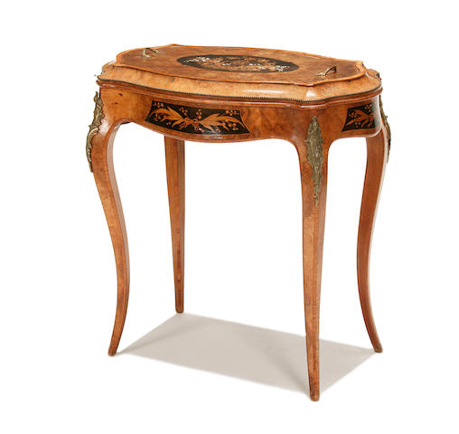 A Victorian figured walnut, marquetry and gilt metal mounted jardiniere table