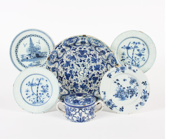 A pair of English delft plates, two other plates, a large dish and a twin-handled pot and cover 18th Century.