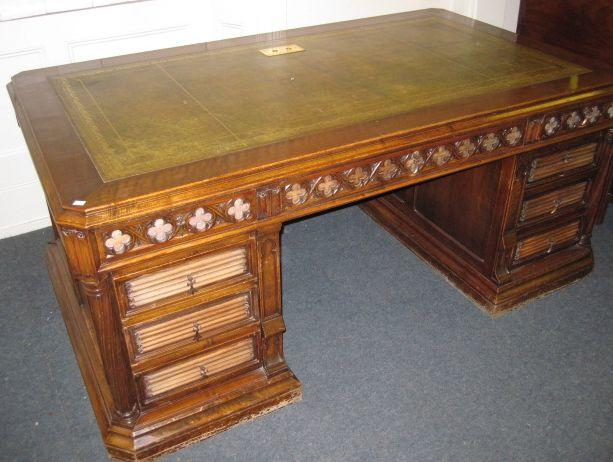 A 'Gothic Revival' walnut kneehole desk,