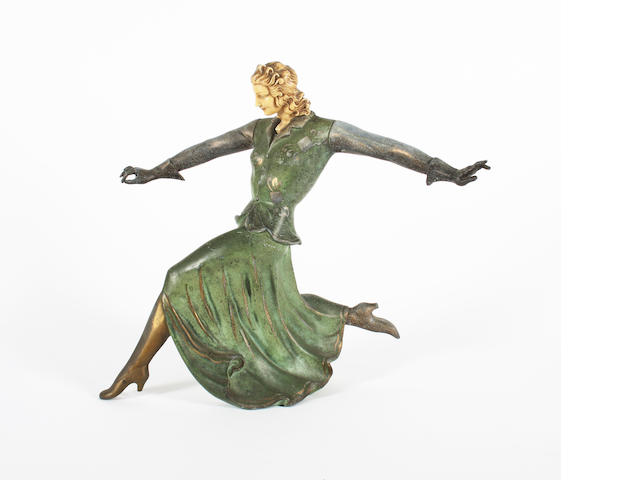 An art deco cold painted spelter and ivorine mounted figure of a woman running
