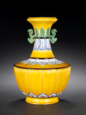 A rare archaistic enamelled moulded vase 18th century