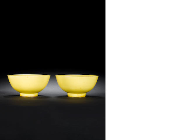 A pair of yellow-enamelled bowls Kangxi six-character marks and of the period