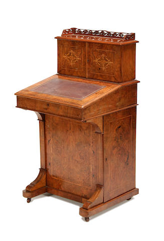 A Victorian figured walnut and inlaid davenport
