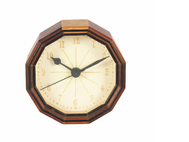 A small Hugh Birkett multi-wood wall timepiece