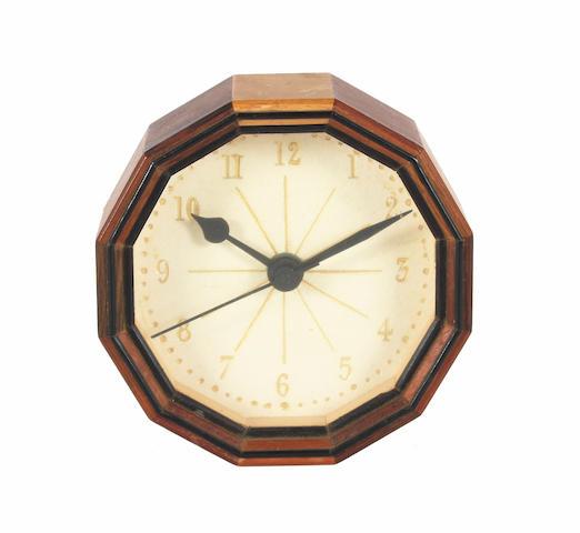 A small Hugh Birkett multi-wood wall timepiece