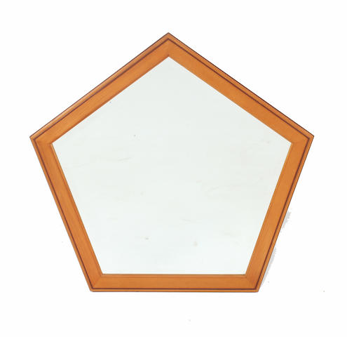 A Hugh Birkett pale wood pentagonal framed wall mirror