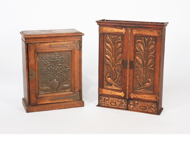 Two Arts & Crafts oak and copper mounted wall cupboards
