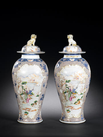 A pair of famille rose vases and covers