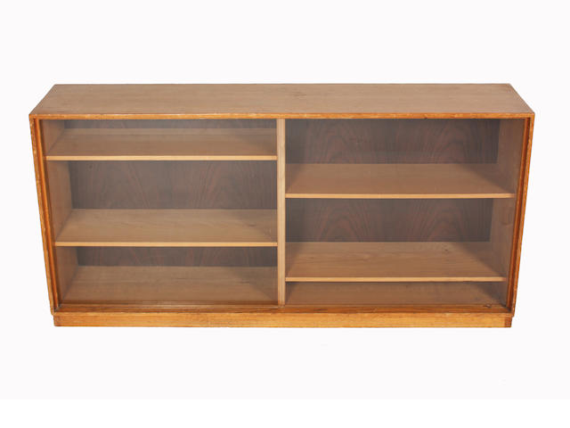A glazed bookcase, by Gordon Russell, 137cm wide.