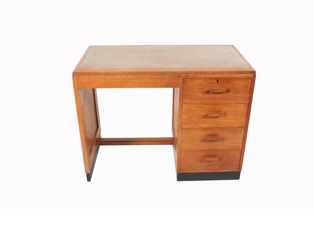 An oak desk by Heales, 100cm wide.