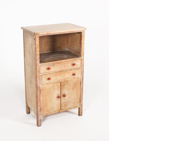 A limed oak side cabinet, by Heales and Sons, 55cm wide.