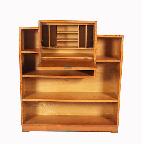 A Heal's golden oak chamfered frame bureau/open bookcase