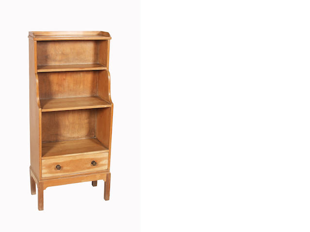 A pine open bookcase, by Heales and Son, 56cm wide.