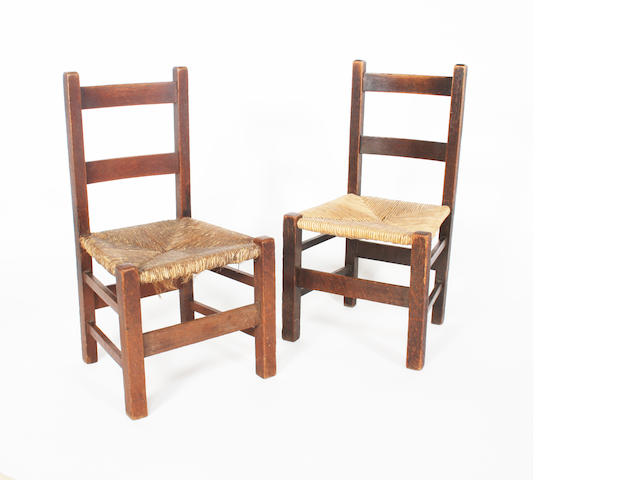 A pair of oak nursery chairs, by Heale and Sons. (2)