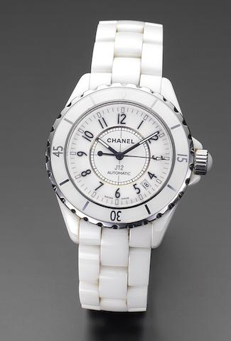 Chanel. An white ceramic automatic calendar bracelet watch together with fitted box and papers J12, Ref:H0970, Serial No: NX67112, Sold 3rd of September 2004