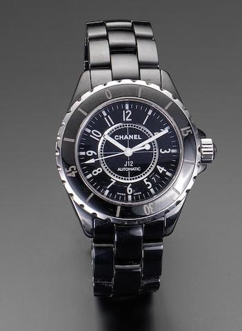 Chanel. A black ceramic automatic calendar bracelet watch together with fitted box and papers J12, Ref:H0685, Serial No: DB02594, Sold in Chanel fine jewellery, London, 5th November 2005
