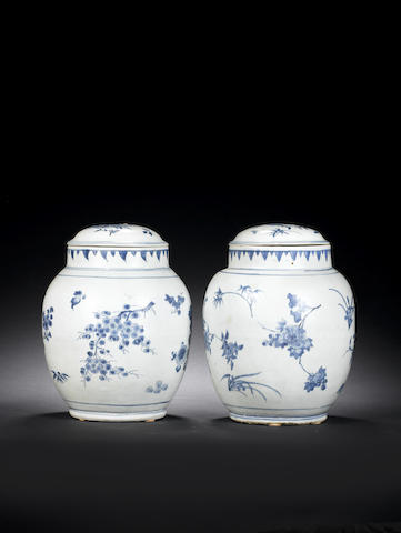 A pair of blue and white 'seed pod' jars and covers Circa 1640
