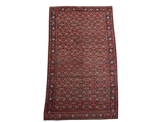 A Tabriz carpet North West Persia, 21 ft x 12 ft 6 in (630 x 380 cm)