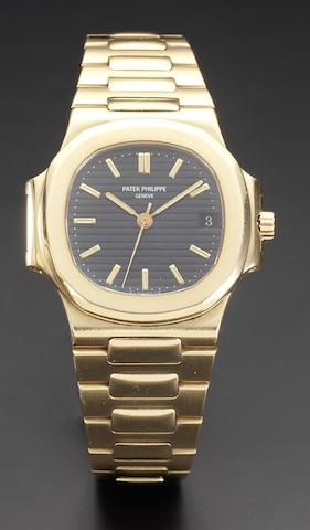 Patek Philippe. A fine 18ct gold automatic centre seconds calendar bracelet watch Nautilus, Ref:3700.