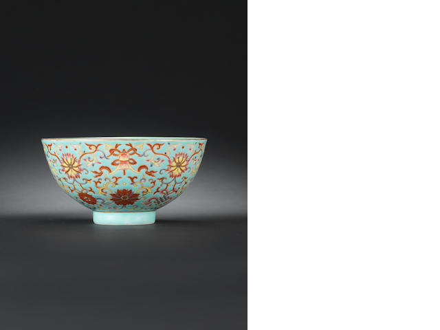A turquoise-ground famille rose 'emblem' bowl Qianlong seal mark and of the period