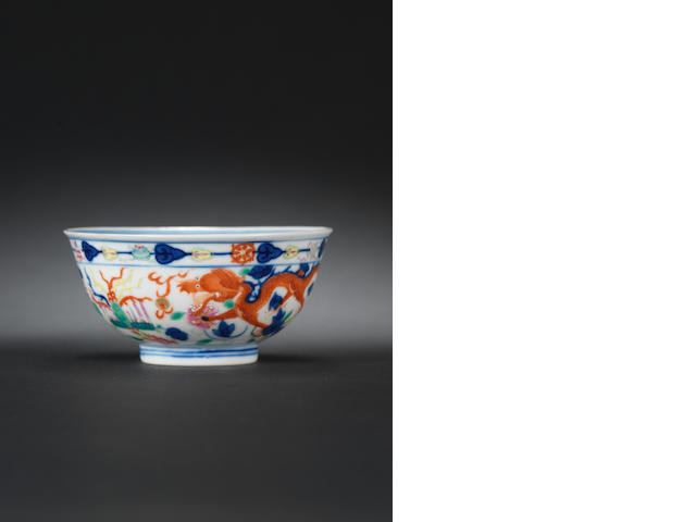 A famille rose 'dragon and phoenix' bowl Tongzhi six-character mark and of the period