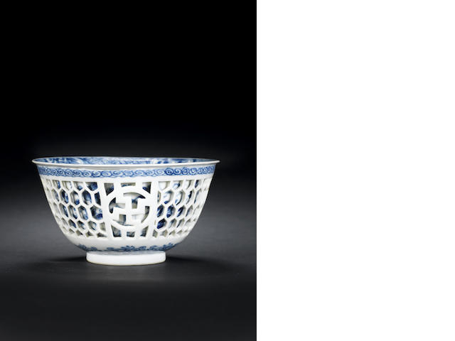 A blue and white reticulated bowl