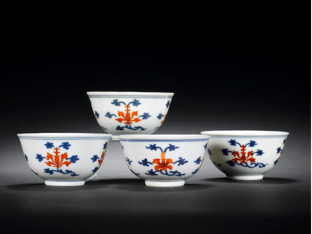 Four iron-red enamelled and blue cups Daoguang marks and of the period